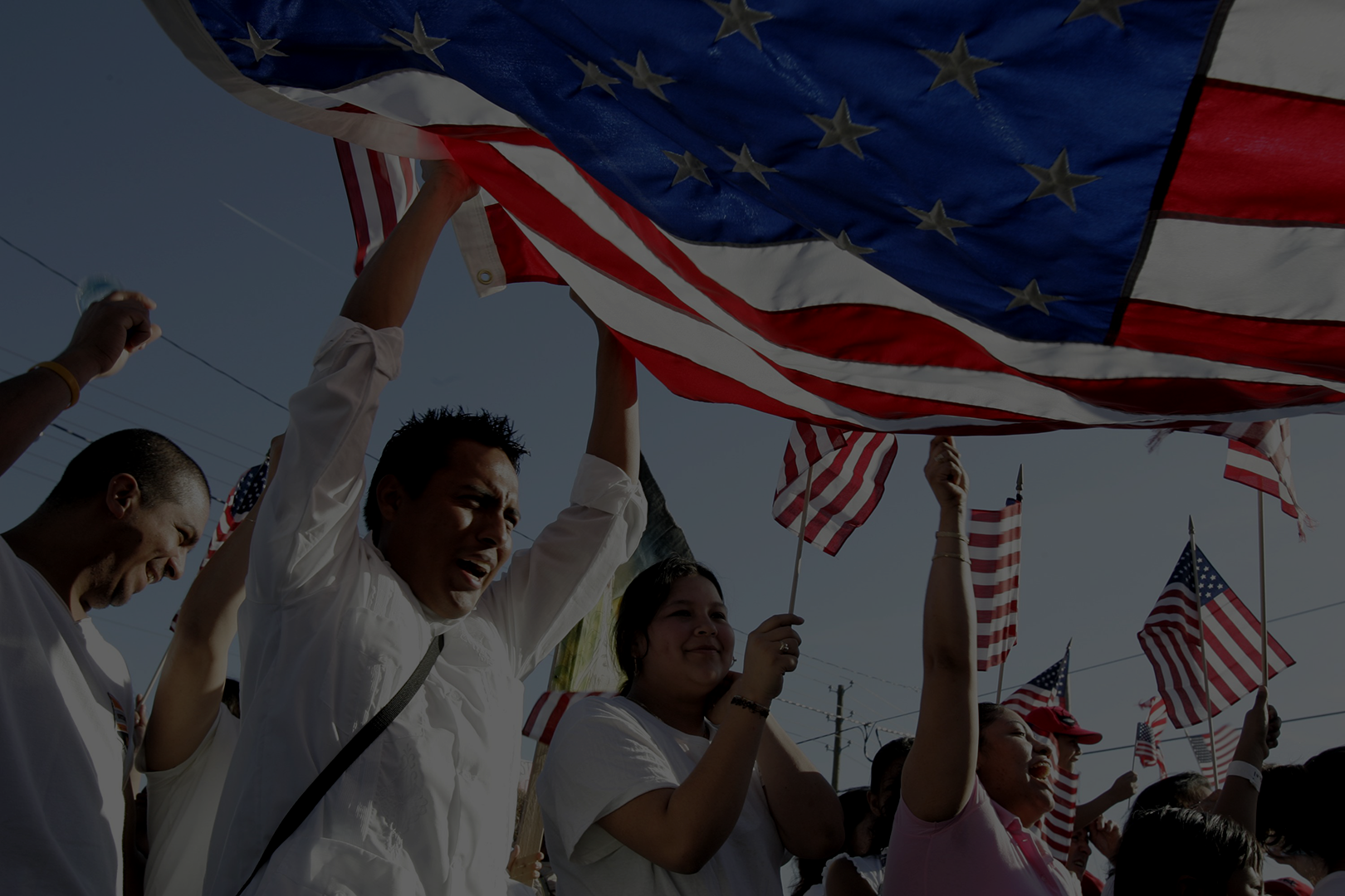 flag-and-immigrants-scaled-dark